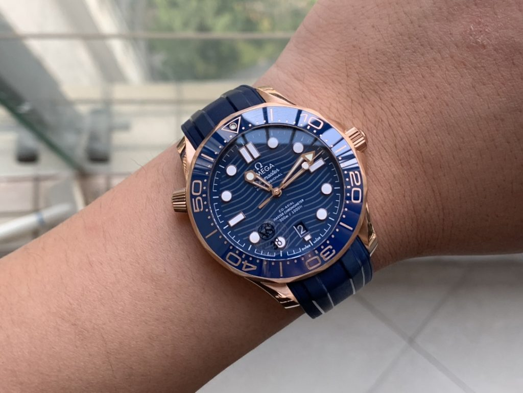 Omega Seamaster Rose Gold Blue Wrist Shot